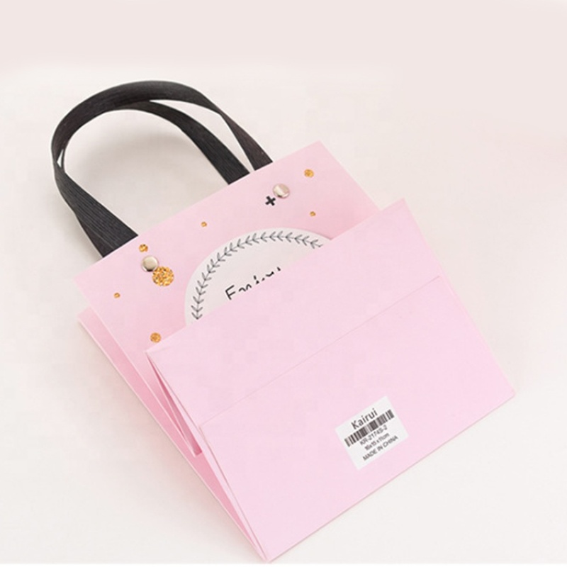 Customized paper shopping pink paper gift hand bag with metal button