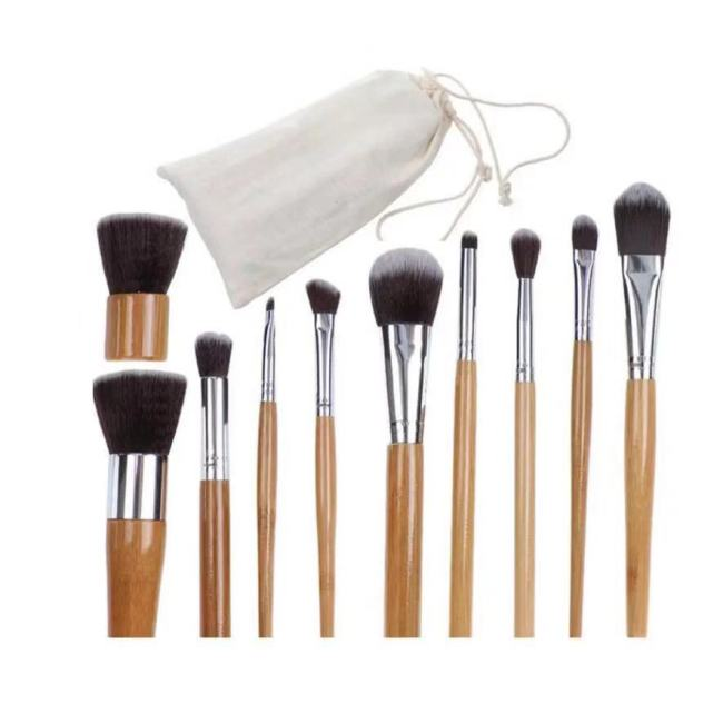 Best selling explosion models 11 bamboo handle makeup brush environmental protection wood color linen bag packaging foundation brush beauty tools
