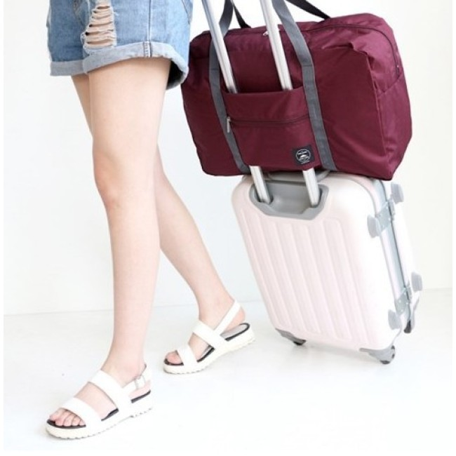Korean version of foldable traveling bag luggage bag moving plane bag men and women packing bag luggage bag storage bag