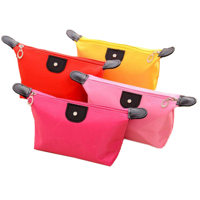 Factory direct Korean candy color dumpling type make-up bag dumpling bag folding waterproof make-up wash wash can print logo